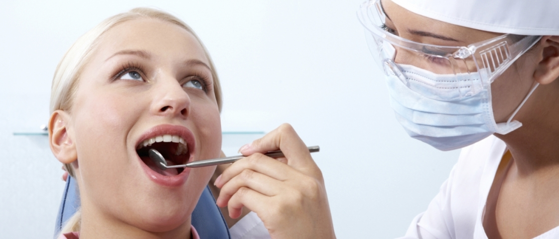 dentist_caring_for_a_woman_in_a_dental_practice